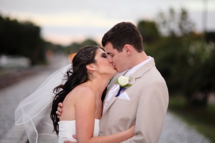 Photo of couple kissing in wedding dress